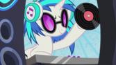 DJ Pon-3 raising a vinyl record S5E9