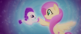 Fluttershy playing with a baby seapony MLPTM