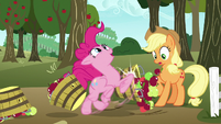 Pinkie knocks over Applejack's baskets as she runs through S7E11