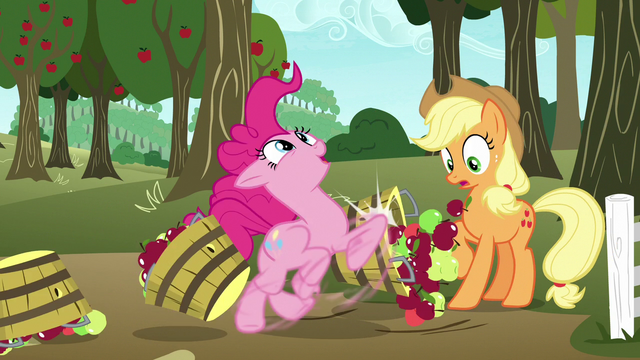 File:Pinkie knocks over Applejack's baskets as she runs through S7E11.png