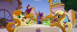 Apple family members holding up pies MLPTM