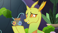 Changeling 1 holding a pottery vase S7E17.png