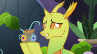 Changeling 1 holding a pottery vase S7E17