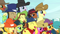 Ponies watching the hay bale monster stack S5E6.png