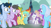 Rarity appears in the crowd of ponies S7E19
