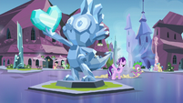 Starlight points toward Spike's statue S6E1