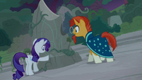 Sunburst and Rarity examine one of the rocks S7E25