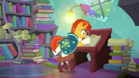 Sunburst flipping through book pages S8E8