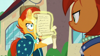 Sunburst holding a multitude of scrolls S8E8