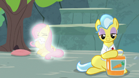 Angel and Fluttershy glow behind Dr. Fauna S9E18