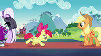 Apple Bloom runs up to Applejack S5E24