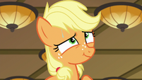 Applejack giving an innocent smile S6E23