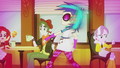 DJ Pon-3 passing by shop patrons EG2.png