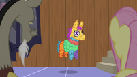 Living pinata hanging from a string S7E12
