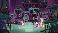 Mane Seven surrounded by caged creatures S8E25