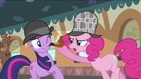Pinkie Pie putting pipe at Twilight's cheek S2E24