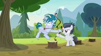Rumble holding Skeedaddle's archery bow S7E21