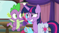 Twilight giving Spike a nervous grin S9E16
