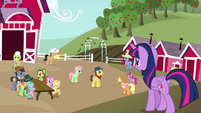 Twilight looking at the Sweet Apple Admirers S7E14