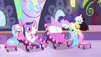 Rarity leaps off of the spa chair MLPS1