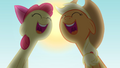 Applejack and Apple Bloom singing with the sun in the sky S4E09.png