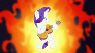 Rarity playing a hard rock guitar solo S7E9