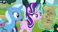 Starlight holding a map of inns S8E19