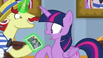 Twilight looks at incriminating photo of herself S8E16