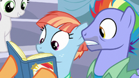 Bow and Windy look closely at Scootaloo's scrapbook S7E7