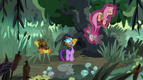 Twilight levitating Fluttershy into the tree S7E20