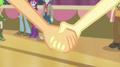 Applejack takes Fluttershy's hand EG2.png