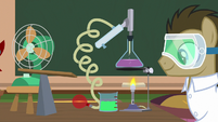 Dr. Hooves next to a big science set S9E20
