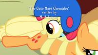 Apple Bloom looks at Applejack's cutie mark S1E23