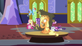 Applejack drifts by on a floating table S6E21.png