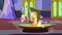 Applejack drifts by on a floating table S6E21