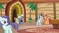 Flim and Gladmane enter the resort lobby S6E20.png