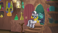 Zecora pointing outside her hut door S7E19