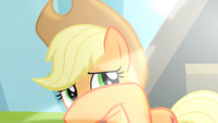 Applejack shielding eyes from the flashes S4E20