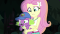Fluttershy loosens her grip on Spike EG4.png