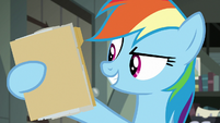Rainbow Dash holding A. K. Yearling's folder S7E18