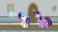Rarity holding a stack of worksheets S8E16