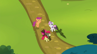 The CMC standing in a field S4E21