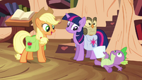 Twilight and Applejack see Spike on the floor S03E11