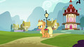 Applejack walking while carrying a bag of apples S5E19.png