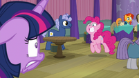 Pinkie trots up to Twilight with a grin S9E16