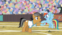 Rainbow Dash stretching Quibble's hoof S9E6