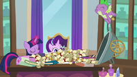 Spike dumps binders and scrolls on Twilight's desk S8E15