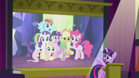 Twilight pointing toward Mane Six slide S5E25