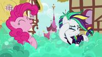 Pinkie whips her bouncy mane near Rarity S7E19