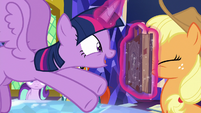 Twilight shoves Star Swirl's journal in AJ's face S7E25